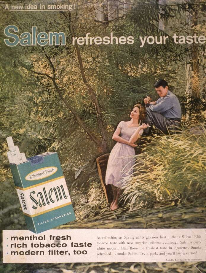 A 1958 print ad for Salem cigarettes showing a couple smoking in the woods and featuring the slogan, Salem refreshes your taste. Photo: Blank Archives, Getty Images / 2003 Getty Images