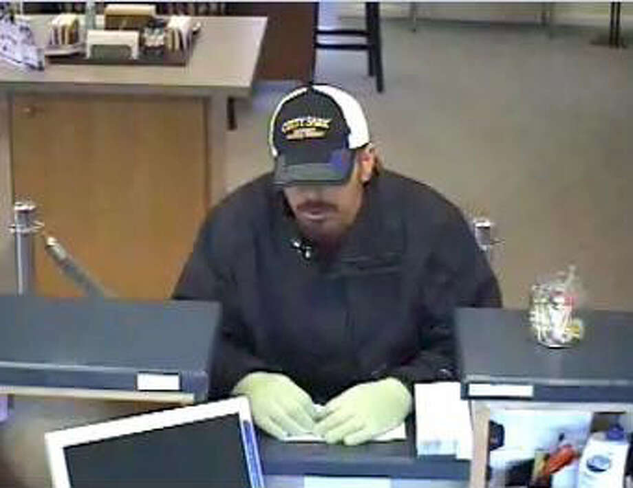 This is a bank surveillance photo of the suspect in Wednesday's robbery at the Naugatuck Savings Bank in Southbury, April 3, 2013. Photo: Contributed Photo