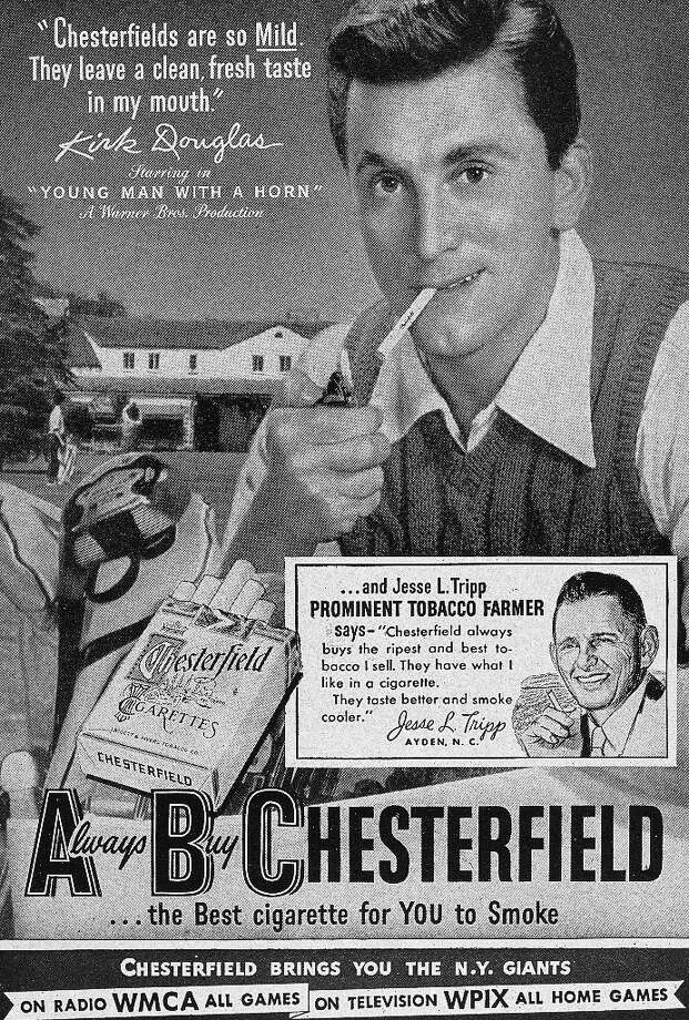 1950:  American actor Kirk Douglas smokes a cigarette in an advertisement for Chesterfield Cigarettes. A slogan proclaims Chesterfield is 'the Best Cigarette for YOU to Smoke.' Photo: Museum Of The City Of New York, Getty Images / Archive Photos