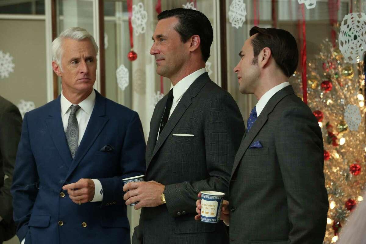 """Sterling Cooper's Roger Sterling (John Slattery, from left), Don Draper (Jon Hamm) and Pete Campbell (Vincent Kartheiser) celebrate in """"Mad Men."""""""