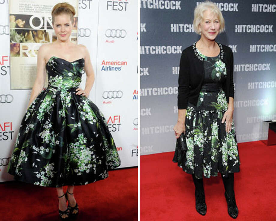 Amy Adams and Helen Mirren  With that cardigan and without Adams\' poofy skirt, Mirren looks like she\'s wearing the old-lady version of the same dress.