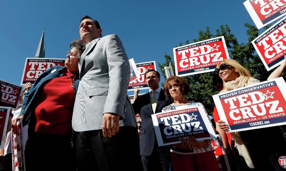 Republican candidate for U.S. Senate Ted Cruz, right, hugs campaign volunteer Maggie Wright, left, as he talks with the media outside a polling location Tuesday, Nov. 6, 2012, in Houston. Cruz is running against Democrat Paul Sadler to replace retiring U.S. Sen. Kay Bailey Hutchison. Photo: David J. Phillip, Associated Press