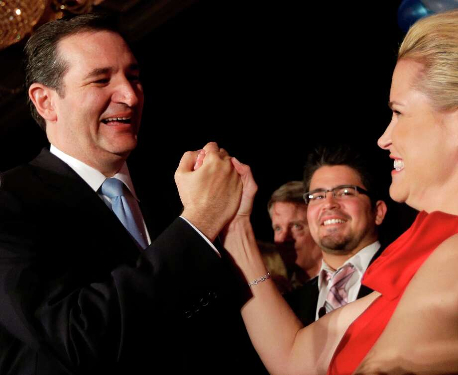Republican candidate for U.S. Senate Ted Cruz celebrates with his wife Heidi during a victory speech Tuesday, Nov. 6, 2012, in Houston. Cruz defeated Democrat Paul Sadler to replace retiring U.S. Sen. Kay Bailey Hutchison. Photo: David J. Phillip, Associated Press