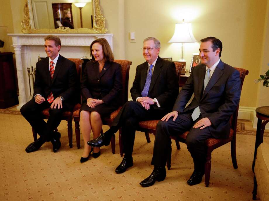 Senate Minority Leader Mitch McConnell of Ky., second from right, meets with newly elected GOP Senators, Tuesday, Nov. 13, 2012, on Capitol Hill in Washington. From left are, Sen-elect Jeff Flake, R-Ariz., Sen-elect Deb Fischer, R-Neb, McConnell, and Sen-elect Ted Cruz, R-Texas. Photo: Pablo Martinez Monsivais, Associated Press