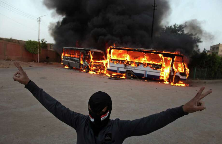 The violence near the Muslim Brotherhood's headquarters has triggered a divisive confrontation. Photo: Khalil Hamra, STF / AP