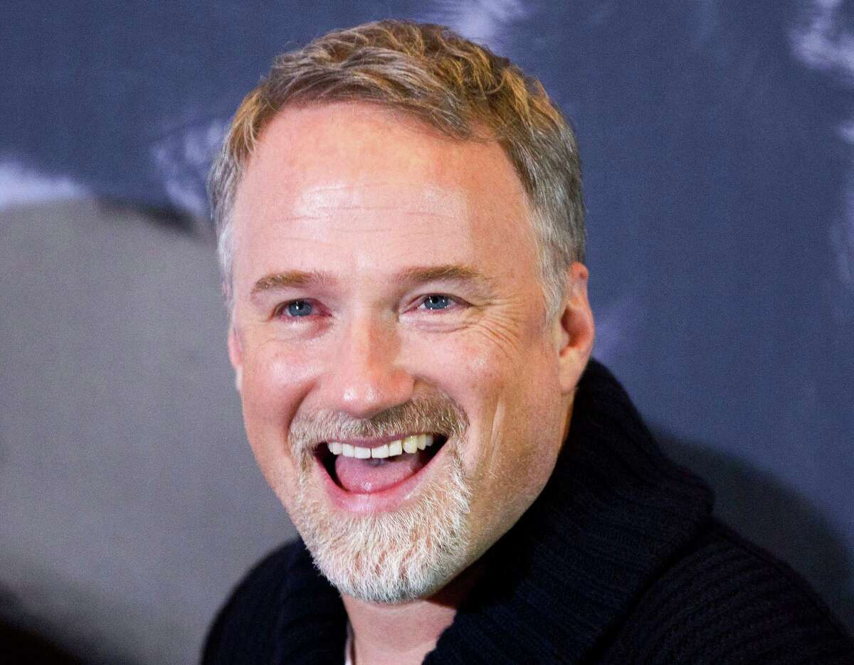 """In this photo taken Jan. 5, 2012, U.S. director David Fincher smiles during a photo call for the movie """"The Girl with the Dragon Tattoo""""in Berlin, Germany. The Walt Disney Studios will film a new version of """"20,000 Leagues Under the Sea"""" in Australia after the country agreed to pay it 21.6 million Australia dollars ($22.6 million) to film the movie there. The inducement announced Tuesday, April 2, 2013, is the biggest ever paid by an Australian government to bring in a Hollywood production. Fincher will direct the Jules Verne science fiction classic, said Disney Asia-Pacific spokeswoman Alannah Hall-Smith. (AP Photo/Gero Breloer)"""