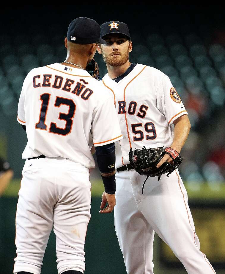 Astros starting pitcher Philip Humber chats with shortstop Ronny Cedeno Rangers third baseman Adrian Beltre was at bat during the sixth inning. Photo: Karen Warren, Chronicle / © 2013 Houston Chronicle