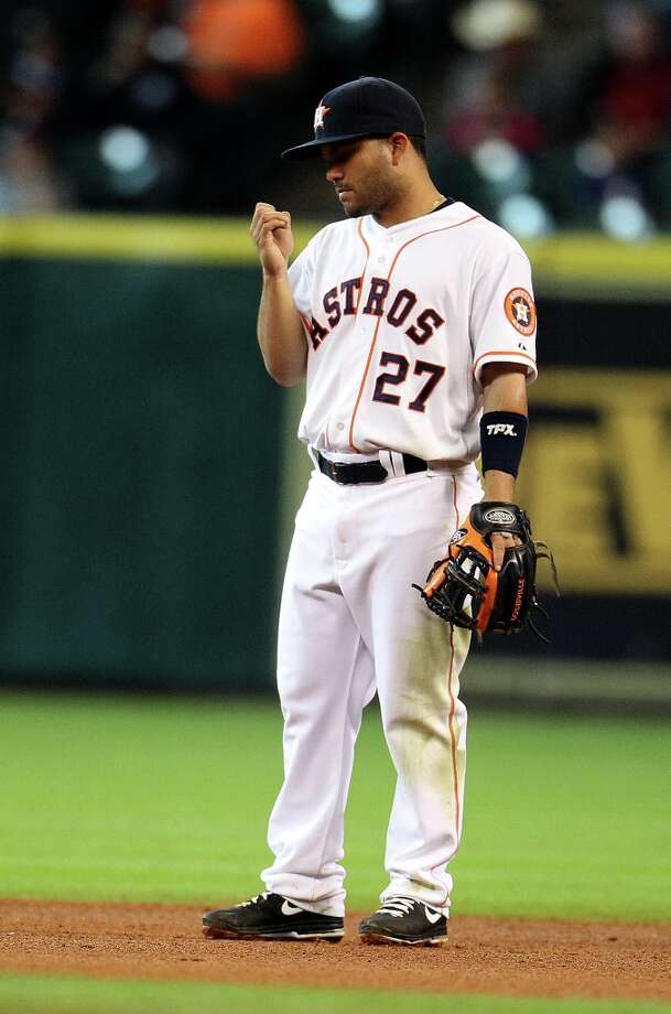 Astros second baseman Jose Altuve bites his nails in the infield during the sixth inning. Photo: Karen Warren, Chronicle / © 2013 Houston Chronicle