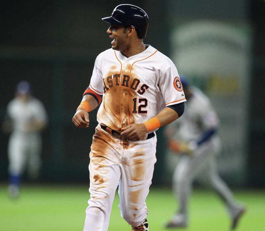 Astros first baseman Carlos Pena talks as teammate Chris Carter flies out to end the sixth inning. Photo: Karen Warren, Chronicle / © 2013 Houston Chronicle