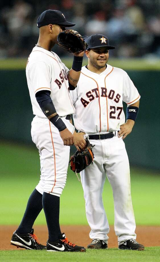 Astros second baseman Jose Altuve (27) and shortstop Ronny Cedeno chat during a pitching change during the sixth inning. Photo: Karen Warren, Chronicle / © 2013 Houston Chronicle