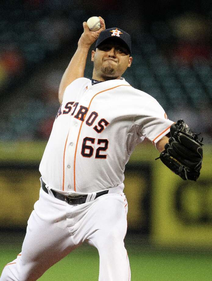 Astros relief pitcher Hector Ambriz pitches during the eighth inning. Photo: Karen Warren, Chronicle / © 2013 Houston Chronicle