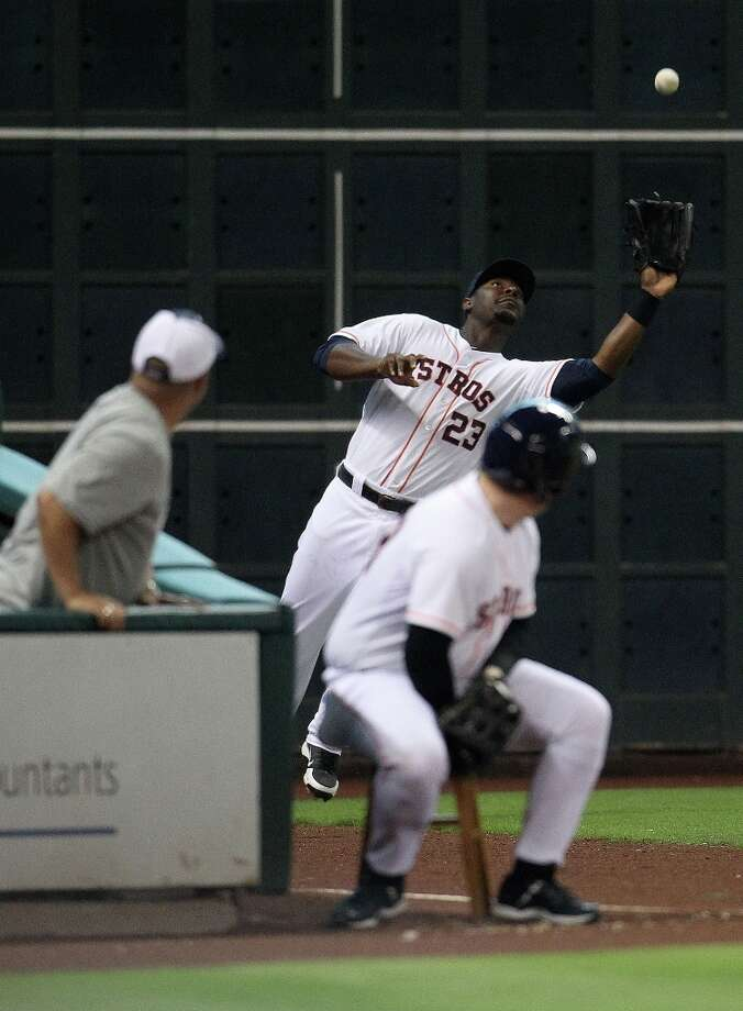 Astros first baseman Chris Carter is called for the error as he failed to catch a sacrifice fly by Rangers catcher A.J. Pierzynski during the eighth  inning. Photo: Karen Warren, Chronicle / © 2013 Houston Chronicle