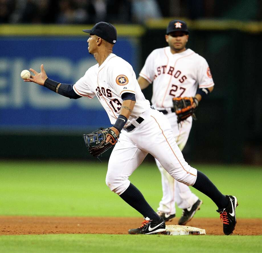 Astros shortstop Ronny Cedeno bobbles the ball as he fails to turn a double play on Rangers first baseman Mitch Moreland after tagging out catcher A.J. Pierzynski at second base during the eighth inning. Photo: Karen Warren, Chronicle / © 2013 Houston Chronicle