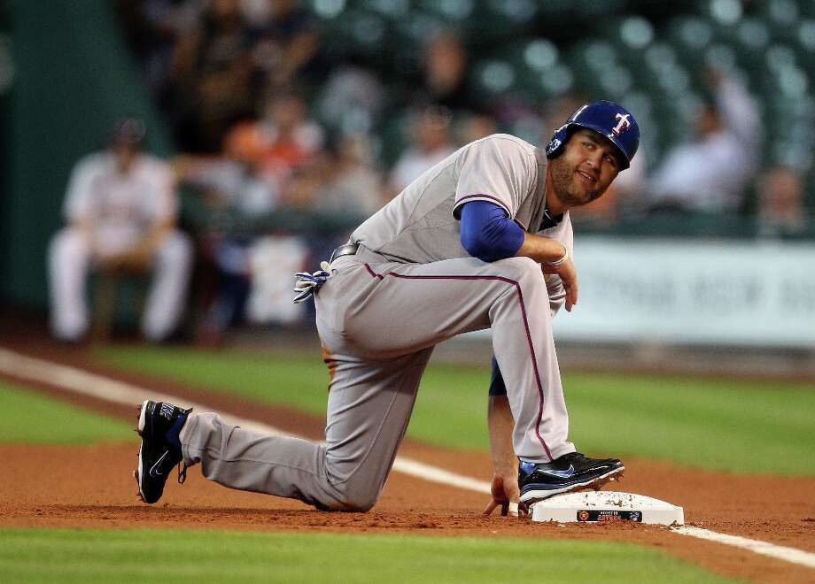 Rangers first baseman Lance Berkman kneels on first base after he attempted to steal second base during the first inning. Photo: Karen Warren , Chronicle / © 2013 Houston Chronicle