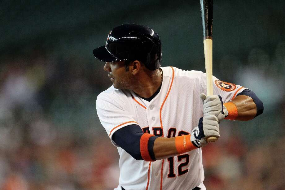 Astros first baseman Carlos Pena bats during the first inning. Photo: Karen Warren , Chronicle / © 2013 Houston Chronicle