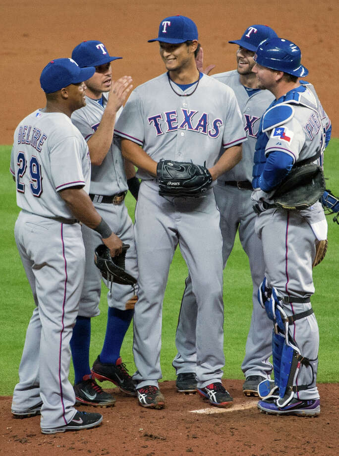 April 2: Rangers 7, Astros 0 Rangers pitcher Yu Darvish is consoled by his teammates after his bid for a perfect game came up short against the Astros. Photo: Smiley N. Pool, Houston Chronicle / © 2013  Smiley N. Pool