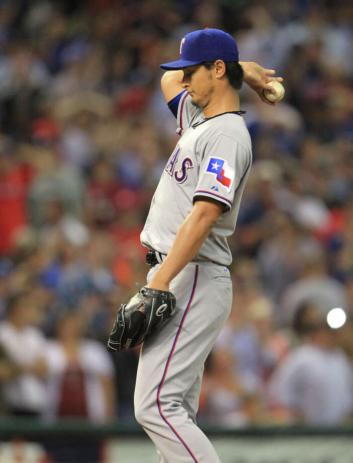 Rangers pitcher Yu Darvish reacts after allowing the Astros first hit during the ninth inning. Photo: Karen Warren, © 2013 Houston Chronicle / © 2013 Houston Chronicle