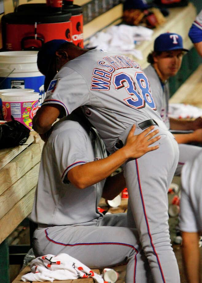Rangers pitcher Yu Darvish and manager Ron Washington embrace. Photo: Cody Duty, © 2013 Houston Chronicle / © 2013 Houston Chronicle