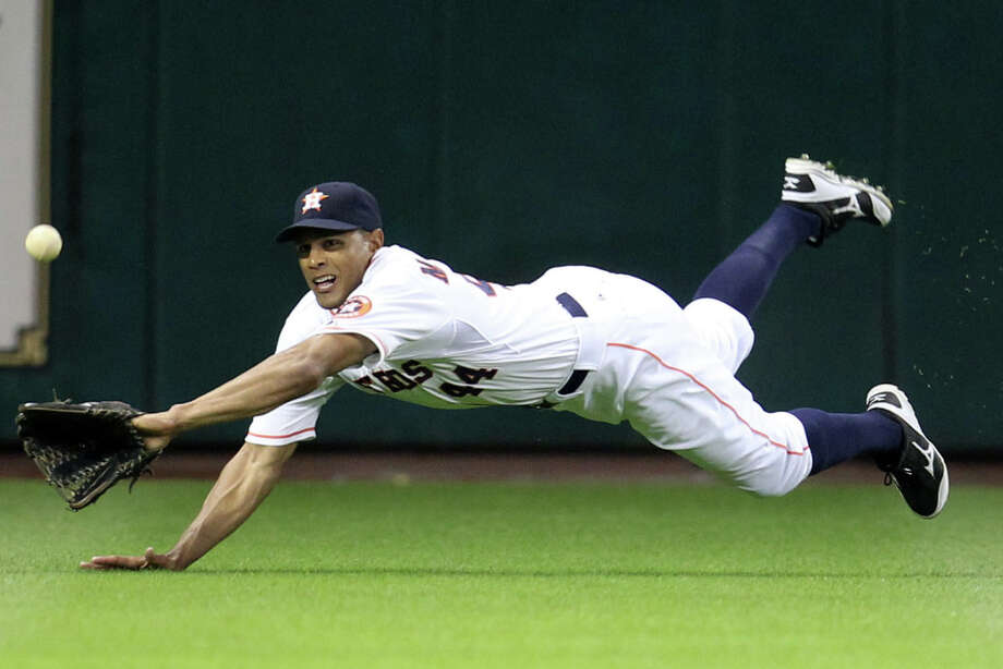 March 31: Astros 8, Rangers 2Astros center fielder Justin Maxwell dives for the out on Texas Rangers shortstop Elvis Andrus during the third inning. Photo: Karen Warren, Houston Chronicle / © 2013 Houston Chronicle