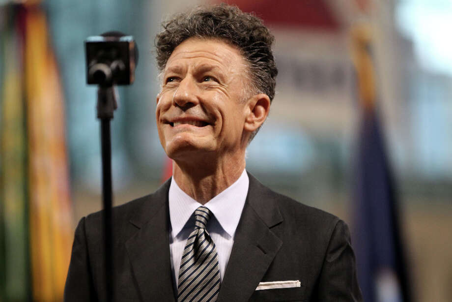 Lyle Lovett smiles before singing the National Anthem. Photo: Karen Warren, Houston Chronicle / © 2013 Houston Chronicle
