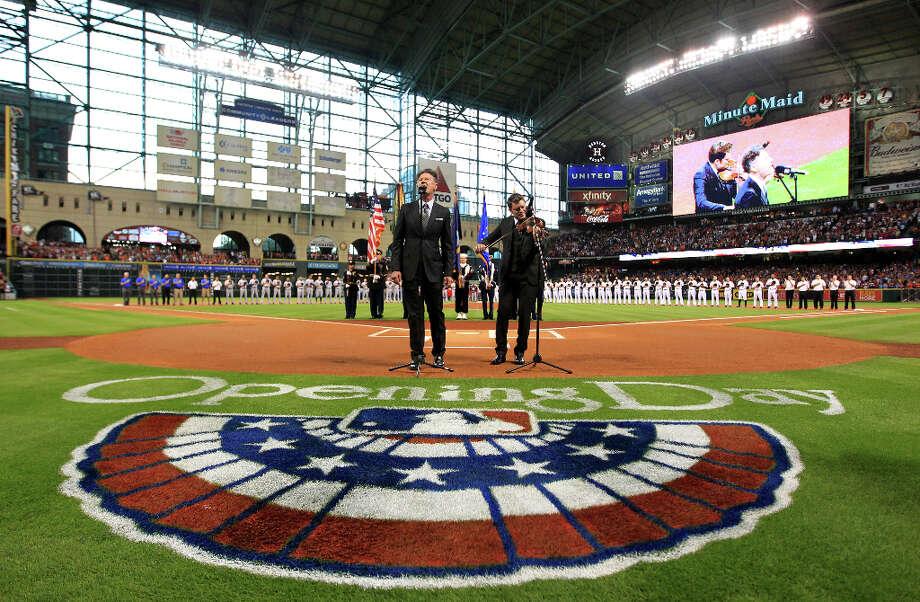 Lyle Lovett sings the National Anthem before the the game. Photo: Karen Warren, Houston Chronicle / © 2013 Houston Chronicle