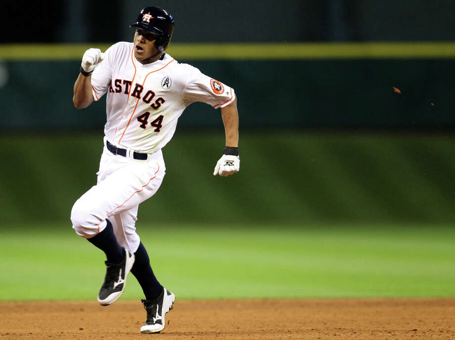 Houston Astros center fielder Justin Maxwell  makes his way to third on his second triple of the night during the eighth inning. Photo: Karen Warren, Houston Chronicle / © 2013 Houston Chronicle