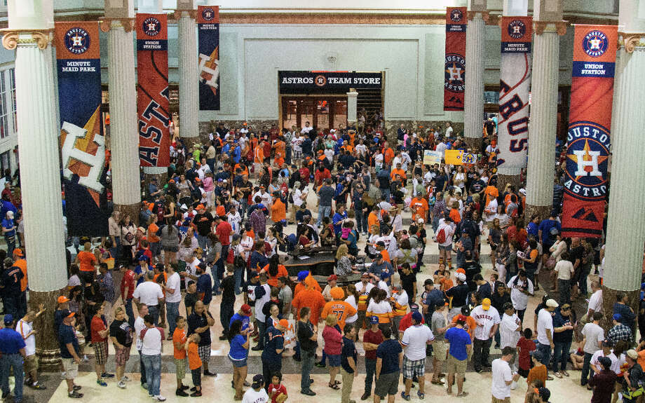 Fans pack the lobby of Union Station waiting for the gates to open before the Astros season opener. Photo: Smiley N. Pool, Houston Chronicle / © 2013  Smiley N. Pool