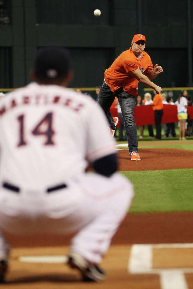 Texans' J.J. Watt throws out the first pitch. Photo: Karen Warren, Houston Chronicle / © 2013 Houston Chronicle