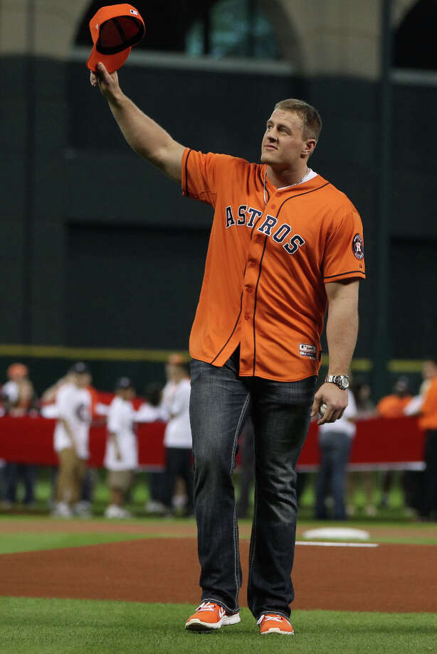 Texans defensive end J.J. Watt waves to the crowd as he prepares to throw out the ceremonial first pitch. Photo: Karen Warren, Houston Chronicle / © 2013 Houston Chronicle