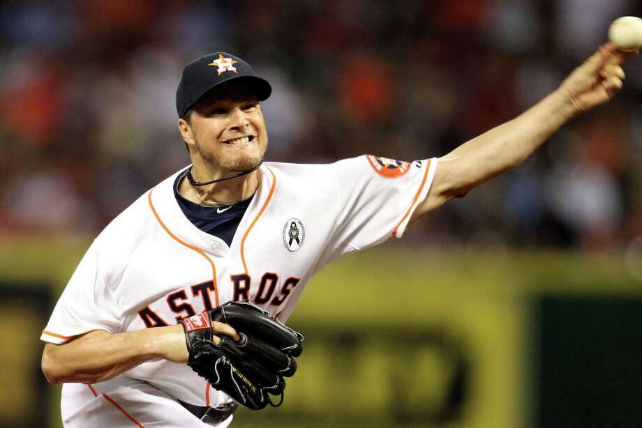 Houston Astros relief pitcher Erik Bedard (pitches during the seventh inning. Photo: Karen Warren, Houston Chronicle / © 2013 Houston Chronicle
