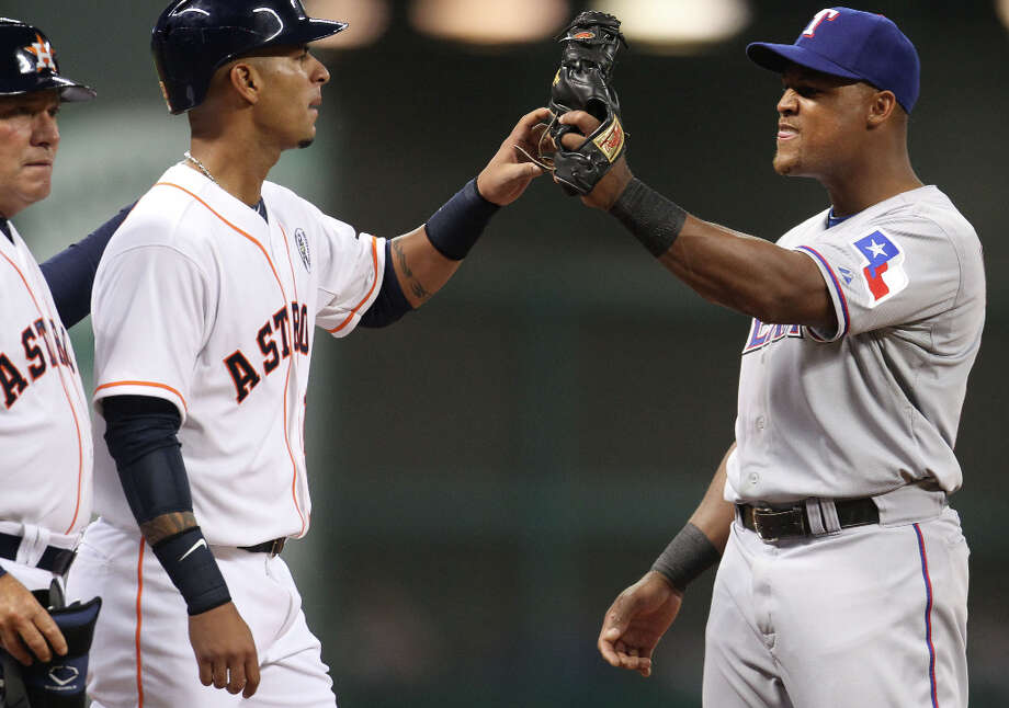 Rangers third baseman Adrian Beltre messes around with Astros shortstop Ronny Cedeno after Cedeno's RBI double during the fifth inning. Photo: Karen Warren, Houston Chronicle / © 2013 Houston Chronicle