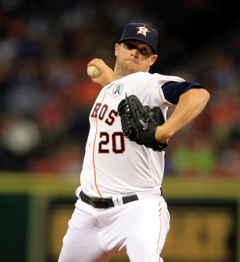 Astros starting pitcher Bud Norris pitches during the first inning. Photo: Karen Warren, Houston Chronicle / © 2013 Houston Chronicle