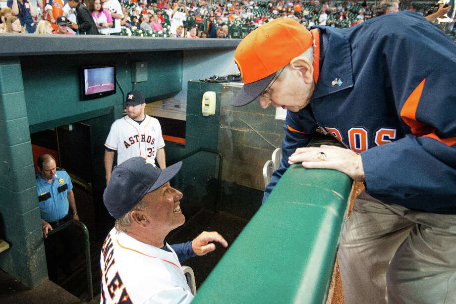 Hall of Fame Broadcaster Milo Hamilton leans over the dugout rail to chat with Astros third base coach Dave Trembley before the season opener. Photo: Smiley N. Pool, Houston Chronicle / © 2013  Smiley N. Pool