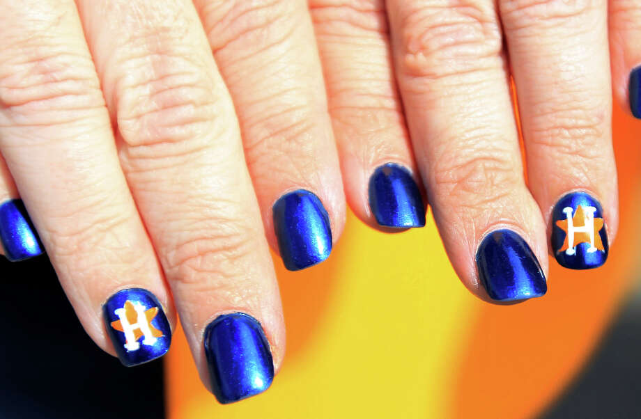 Jennifer Wiggins shows off her Astros nails during the street festival. Photo: Karen Warren, Houston Chronicle / © 2013 Houston Chronicle