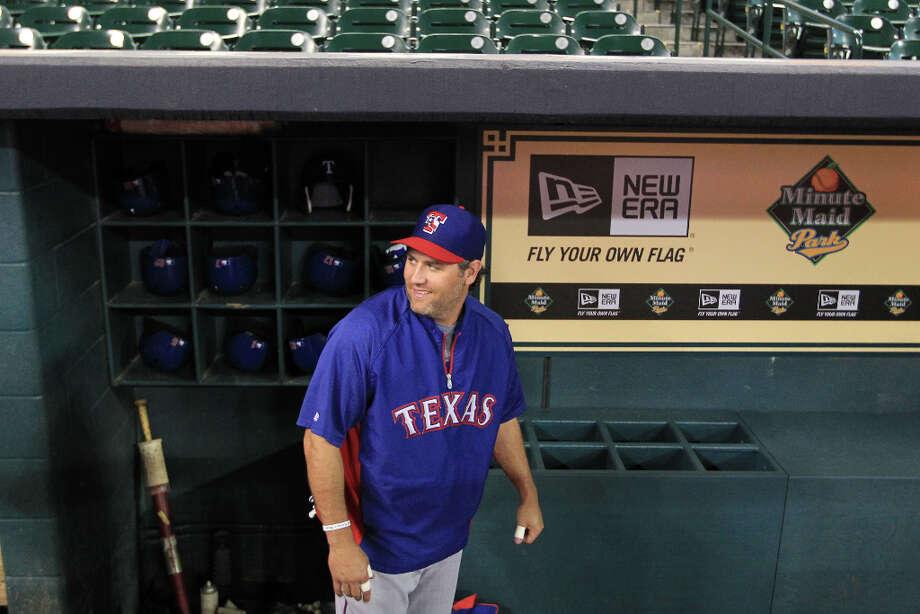 Rangers Lance Berkman in the dugout during batting practice. Photo: Karen Warren, Houston Chronicle / © 2013 Houston Chronicle