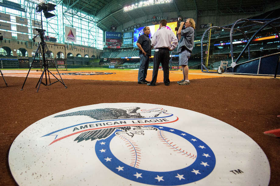 Media do interviews on the field before the Houston Astros inaugural game in the American League. Photo: Smiley N. Pool, Houston Chronicle / © 2013  Smiley N. Pool