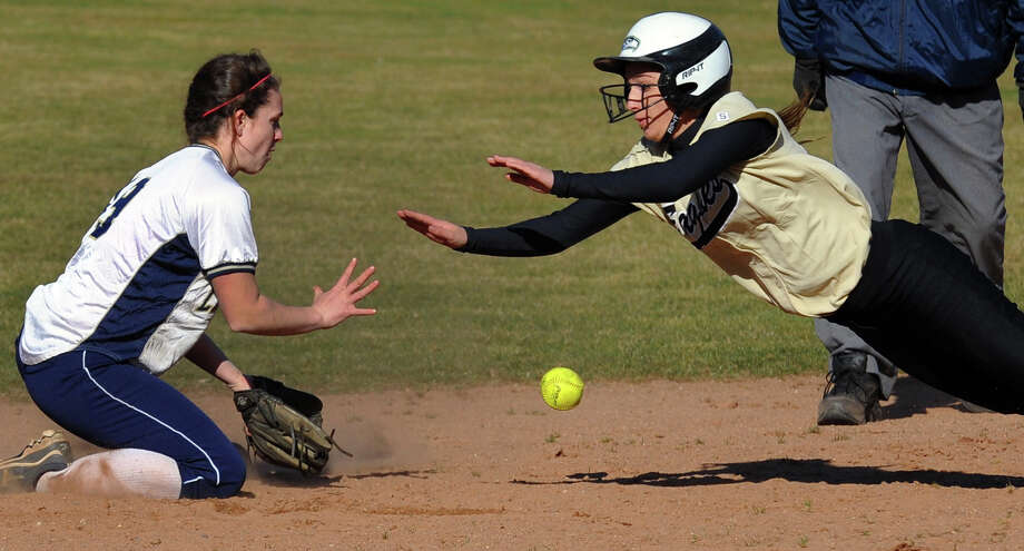 Trumbull's Christie Costello dives into second as Lauralton Hall shortstop Maureen Connolly tries to make the tag, during softball action in Milford, Conn. on Wednesday April 3, 2013. Photo: Christian Abraham / Connecticut Post