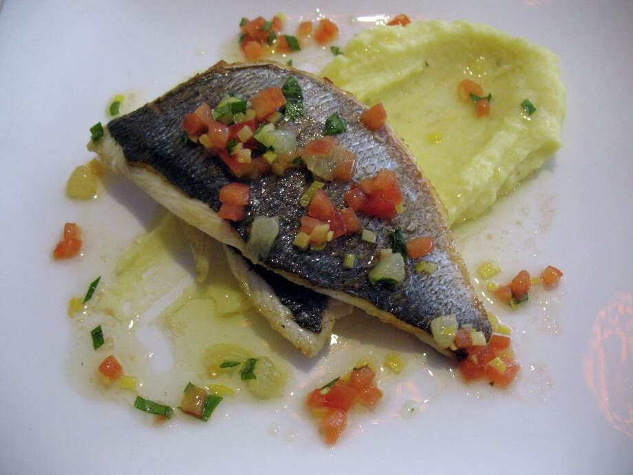 Saveurs 209 offers French favorites as well as a fish of the day; this one was served over creamy mashed potatoes. Photo: Jennifer McInnis / San Antonio Express-News