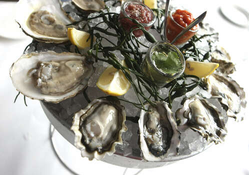 Oysters on the half shell (with sauces) from The Sandbar in the Pearl Brewery. www.sandbarsa.com Photo: Express-News File Photo