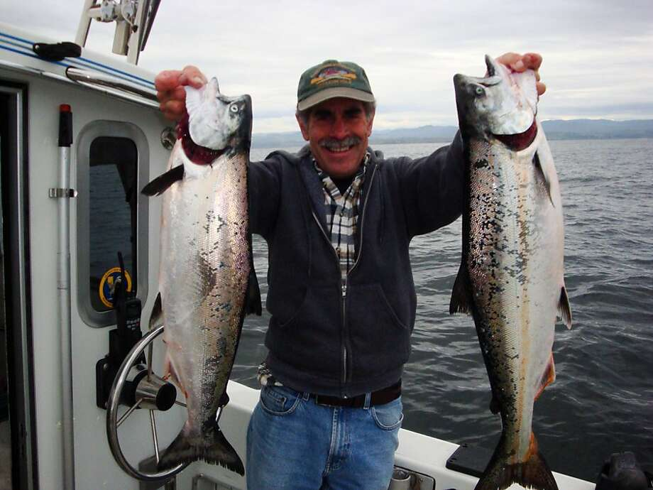 Billy Bassett shows off two salmon caught aboard the Bobby G at Deep Reef out of Half Moon Bay. Salmon season opens Saturday off the California coast with a promising forecast. Photo: Doug Laughlin, Courtesy Photo