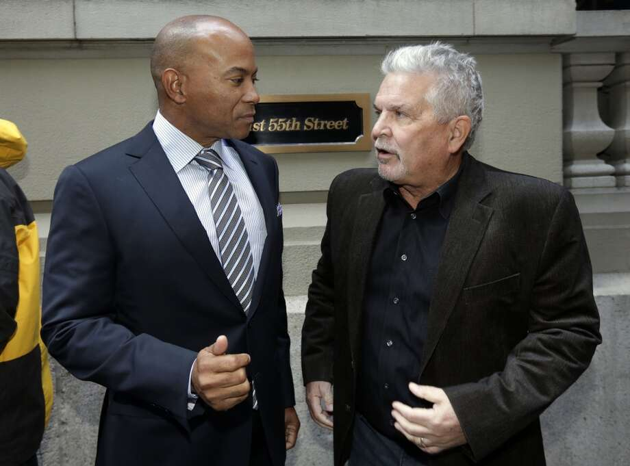 Sacramento city councilman Allen Warren, left, and Sacramento Kings investor Phil Oates confer outside the hotel where the NBA owners are meeting regarding the possible relocation of the Sacramento Kings team to Seattle, in New York,  Wednesday, April 3, 2013. Hedge fund manager Chris Hansen and Microsoft Chief Executive Steve Ballmer have agreed to buy a majority stake in the Kings from the Maloof family for $341 million, but the deal needs league approval.