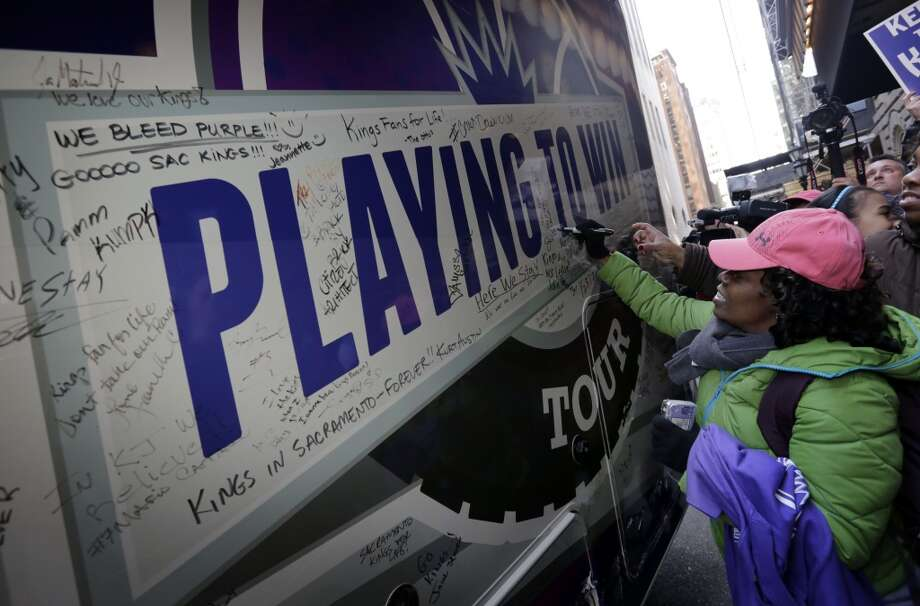 Sacramento Kings fans signs the \'\'Playing to Win\'\' RV parked outside the hotel where NBA meetings regarding the possible relocation of the Sacramento Kings basketball team to Seattle are happening Wednesday, April 3, 2013, in New York. Hedge fund manager Chris Hansen and Microsoft Chief Executive Steve Ballmer have agreed to buy a majority stake in the Kings from the Maloof family for $341 million, but the deal needs league approval.