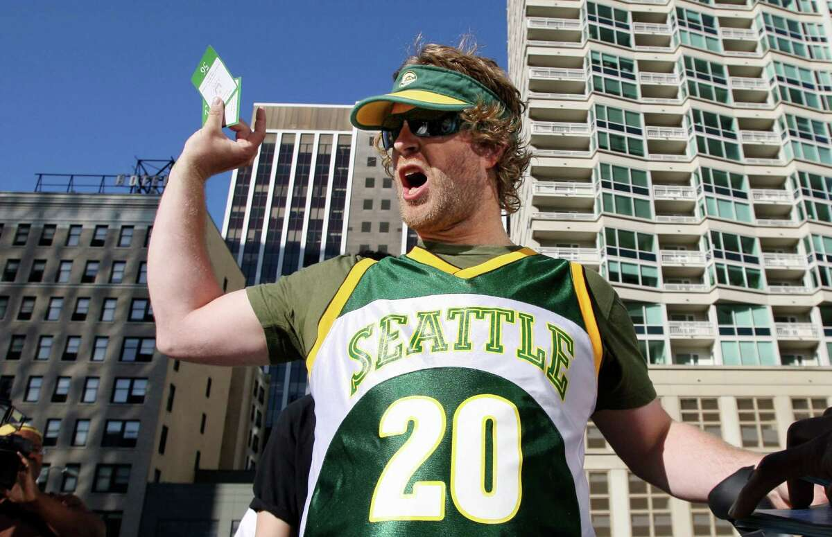 June 2008: Sonics fans protest as the city of Seattle settles with team owner Clay Bennett after he gained NBA approval to relocate the team to Oklahoma City.