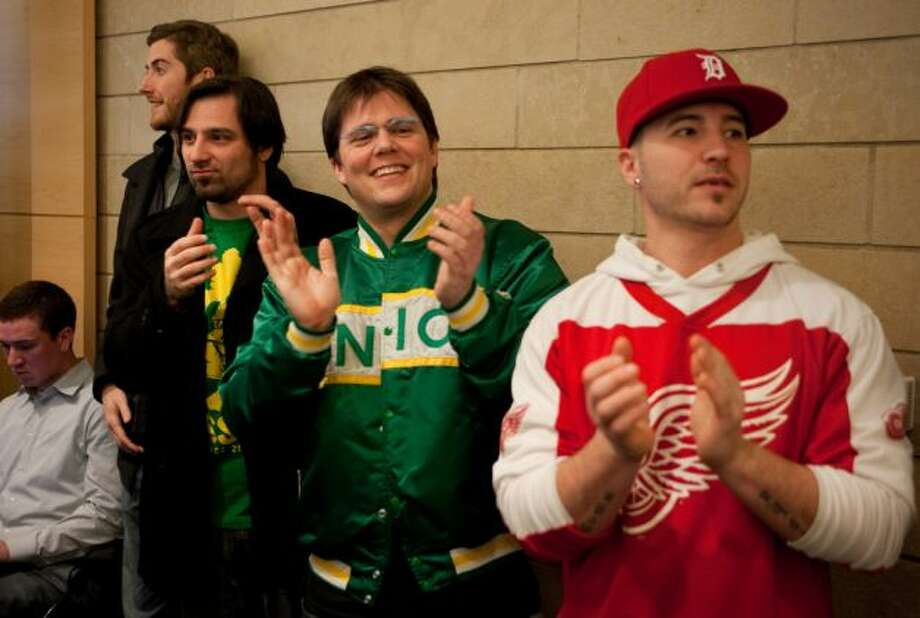 April 27 and 28, 2012: The locally produced documentary ''Sonicsgate,'' on the controversy of the Sonics' departure from Seattle, is nationally televised on CNBC. Above, ''Sonicsgate'' producer Colin Baxter (wearing Sonics jacket) and other fans listen to Mayor Mike McGinn and King County Executive Dow Constantine announce Hansen's plan on Feb. 16, 2012.  Photo: Joshua Trujillo, Seattlepi.com