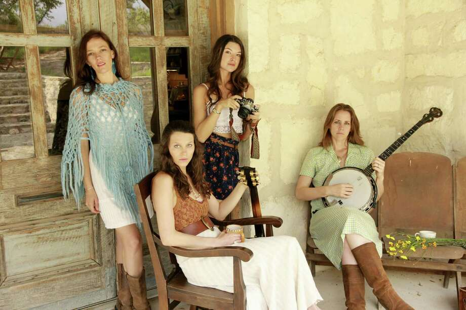 "The Trishas (Jamie Wilson, Liz Foster, Kelley Mickwee and Savannah Welch) are working with their new release ""High, Wide and Handsome."" Photo: Courtesy Photos"