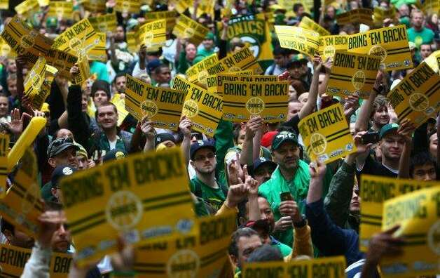 June 14, 2012: Thousands of Sonics fans attend Chris Hansen's rally at Occidental Park in Seattle's Pioneer Square. Hansen is joined by former Sonics stars Shawn Kemp, Gary Payton, Detlef Schrempf and Slick Watts, as well as former Huskies star Nate Robinson. Seattle bands Common Market, the Blue Scholars, Macklemore and Ryan Lewis, and the Presidents of the United States of America perform.  Photo: Joshua Trujillo, Seattlepi.com
