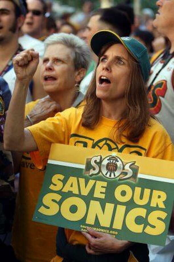 July 11, 2012:A crowded and roudy ''town hall'' meeting, hosted by city and county councilmembers, showcases the public's passionate opinions on all sides of the Sodo debate. Tensions run high as the meeting quickly devolves into a heckling contest: the proponents versus the opponents and skeptics.  Photo: Associated Press