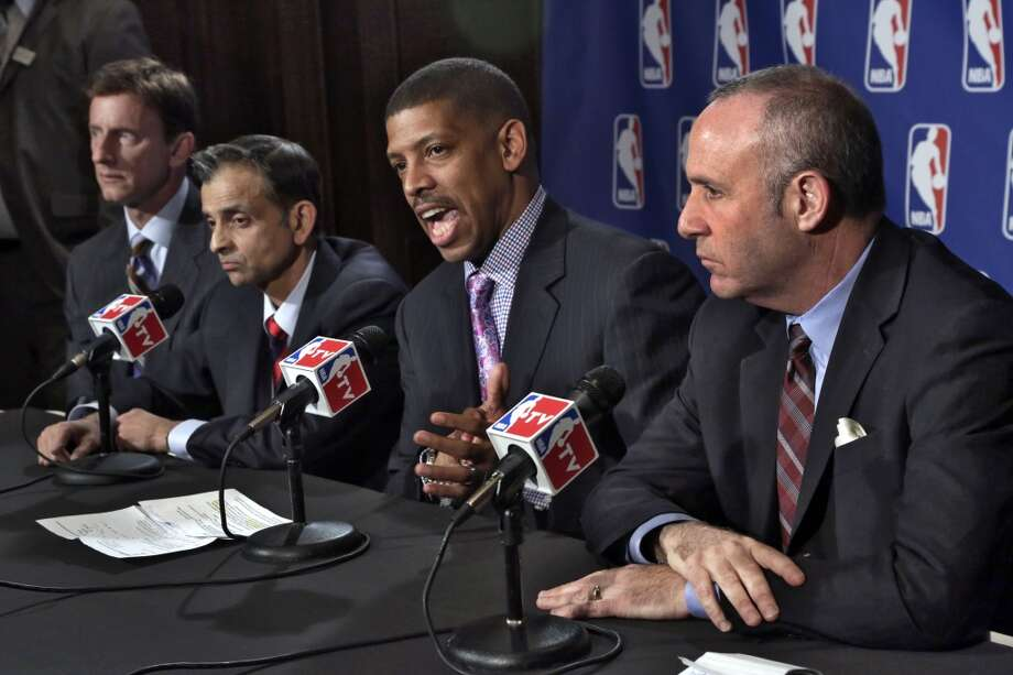 Sacramento Mayor Kevin Johnson, second from right, joined by Mark Mastrov, left, Vivek Ranadive, and California state Sen. Darrell Steinberg, right, speaks to reporters after their meeting with the NBA regarding the the possible relocation of the Sacramento Kings basketball team to Seattle, in New York,  Wednesday, April 3, 2013. Investor Chris Hansen and Microsoft Chief Executive Steve Ballmer have agreed to buy a majority stake in the Kings from the Maloof family for $341 million, but the deal needs league approval.
