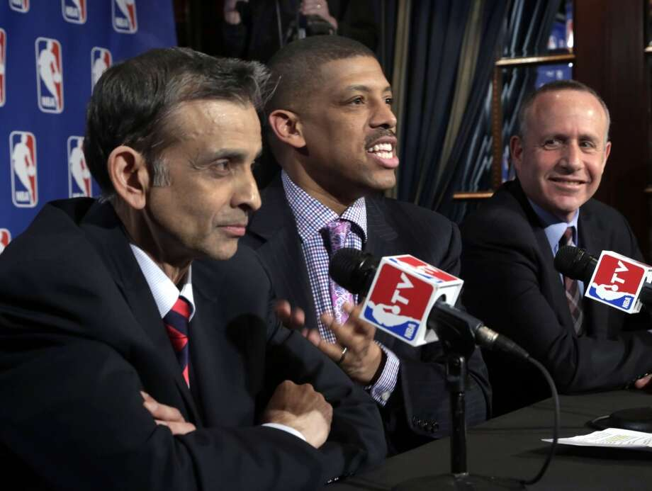 Sacramento Mayor Kevin Johnson, center, is joined by Vivek Ranadive, left, and California state Sen. Darrell Steinberg during interviews Wednesday, April 3, 2013, in New York after their meeting with the NBA regarding the the possible relocation of the Sacramento Kings basketball team to Seattle. Investor Chris Hansen and Microsoft Chief Executive Steve Ballmer have agreed to buy a majority stake in the Kings from the Maloof family for $341 million, but the deal needs league approval.