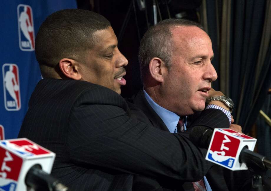 Sacramento Mayor Kevin Johnson, left, hugs California Senate President pro Tem Darrell Steinberg during a news conference after their meeting with the NBA regarding the possible relocation of the Sacramento Kings basketball team to Seattle, Wednesday, April 3, 2013, in New York.